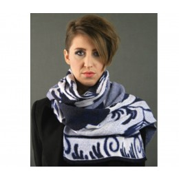 The colors and delft blue motifs are gracefully incorporated into the knitting.